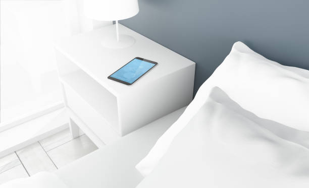 bedroom smartphone stock photo