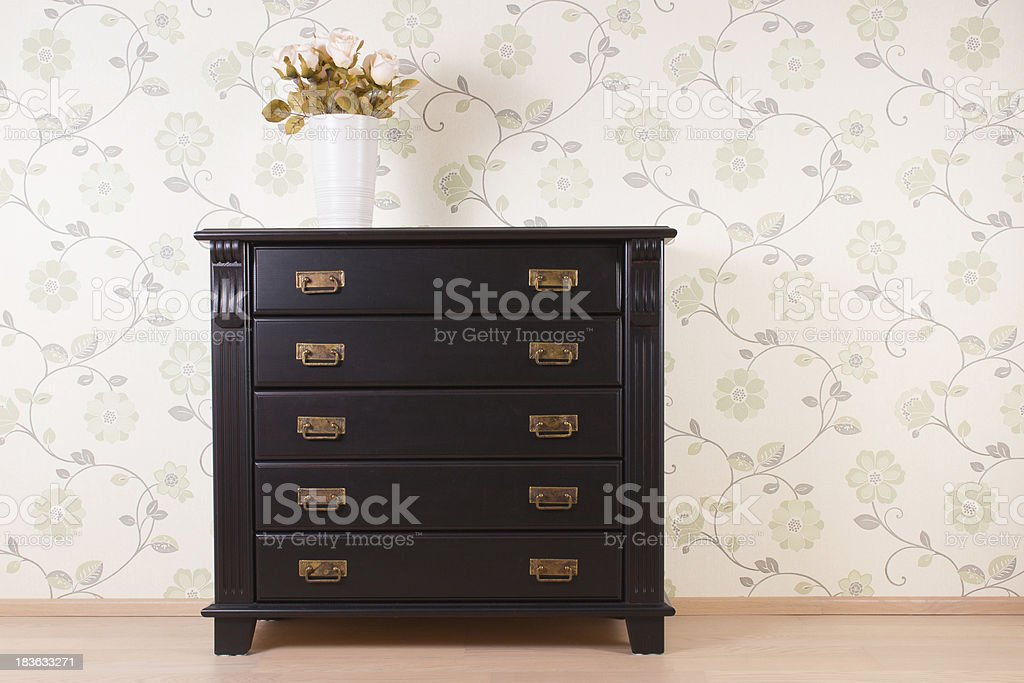 Bedroom wall with classic furniture and roses stock photo