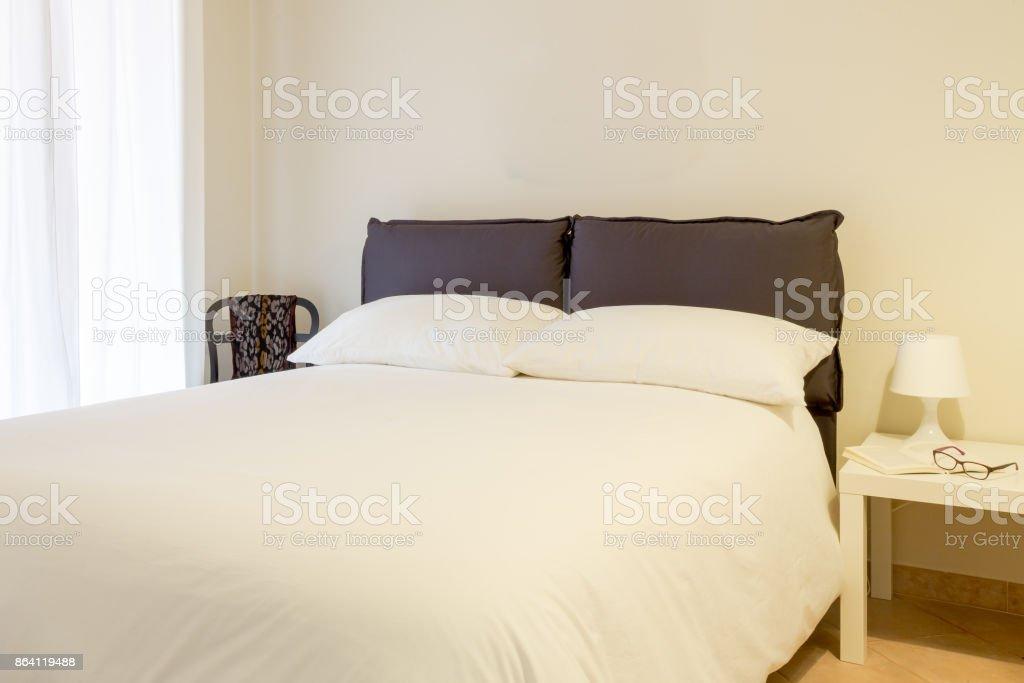 Bedroom. White interior. royalty-free stock photo