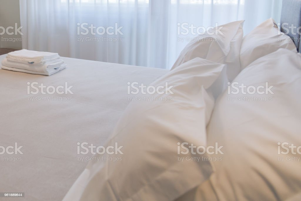 Bedroom. White towels on the bed stock photo