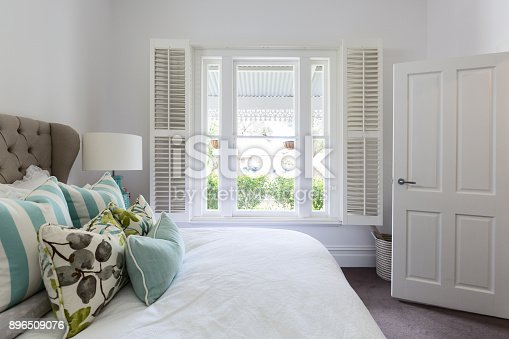 istock Bedroom window with a garden view in a luxury country house bedroom 896509076