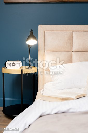 847138534 istock photo bedroom with a dark blue wall 1221165747