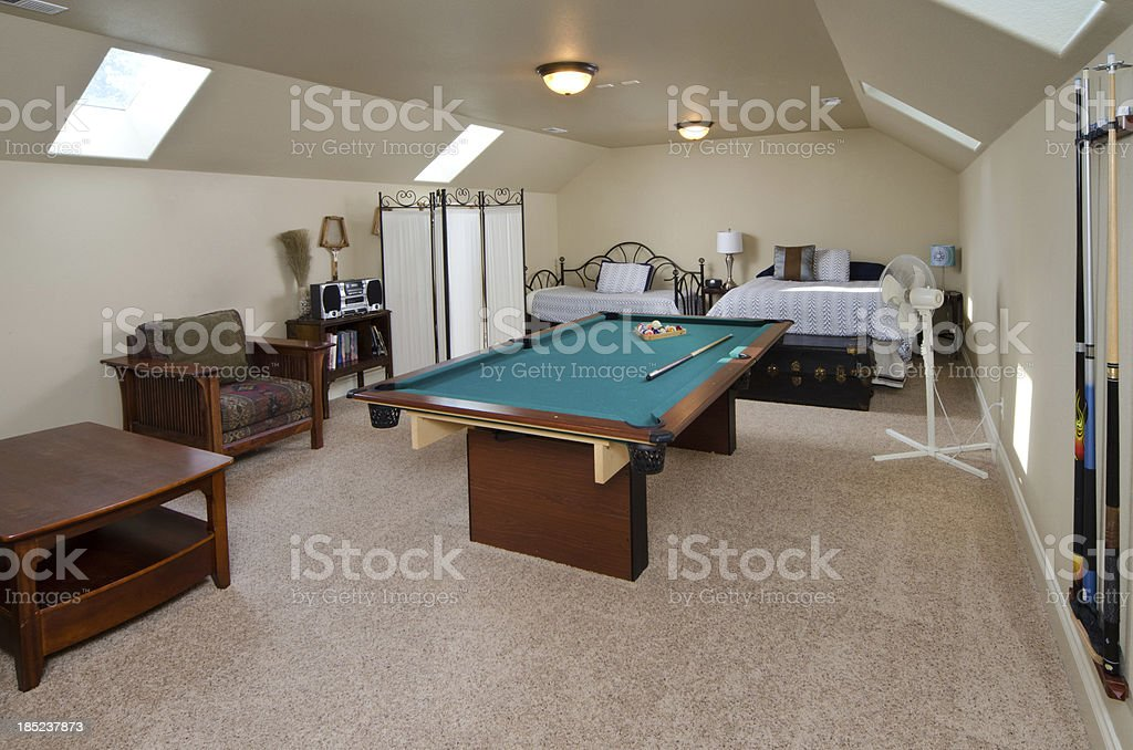 Bedroom with a game room stock photo