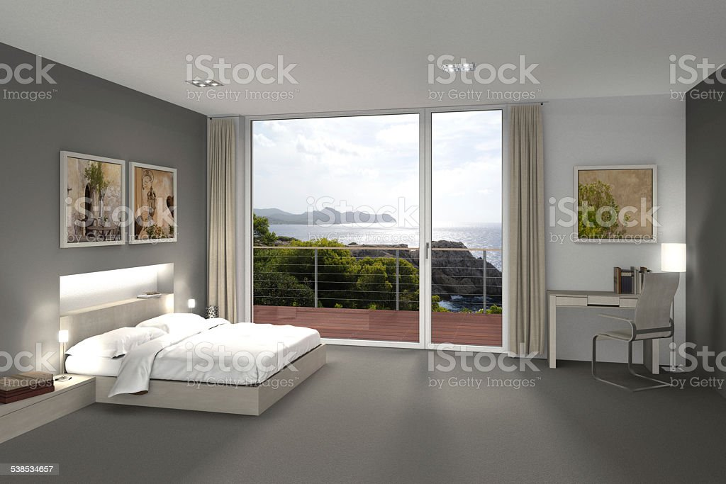 bedroom with a view to the sea stock photo