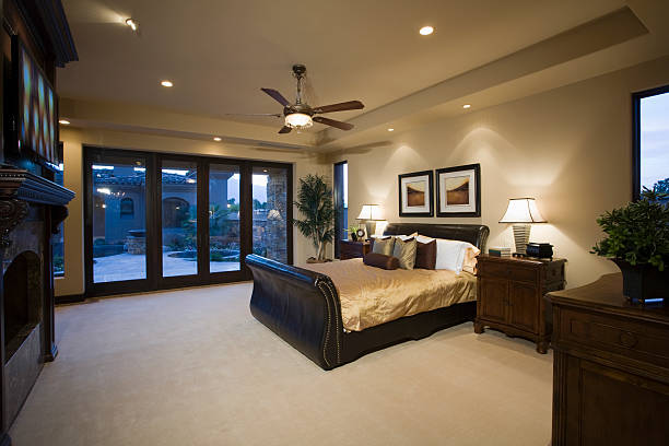 Bedroom With Ceiling Fan Dark wood furniture in bedroom with ceiling fan ceiling fan stock pictures, royalty-free photos & images