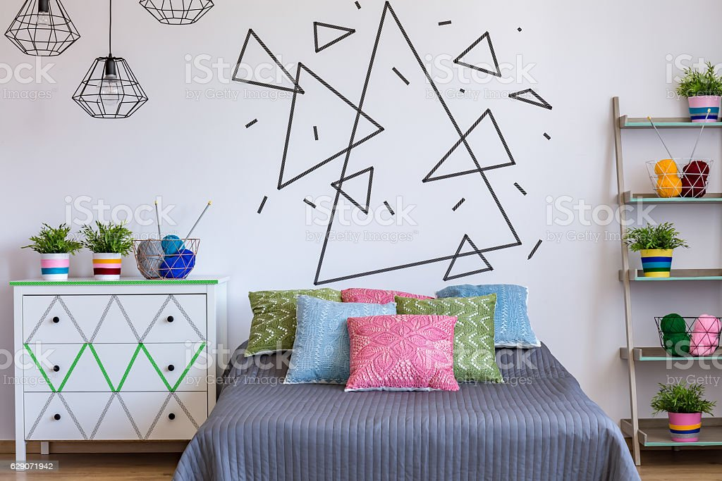 Bedroom with colourful bed stock photo