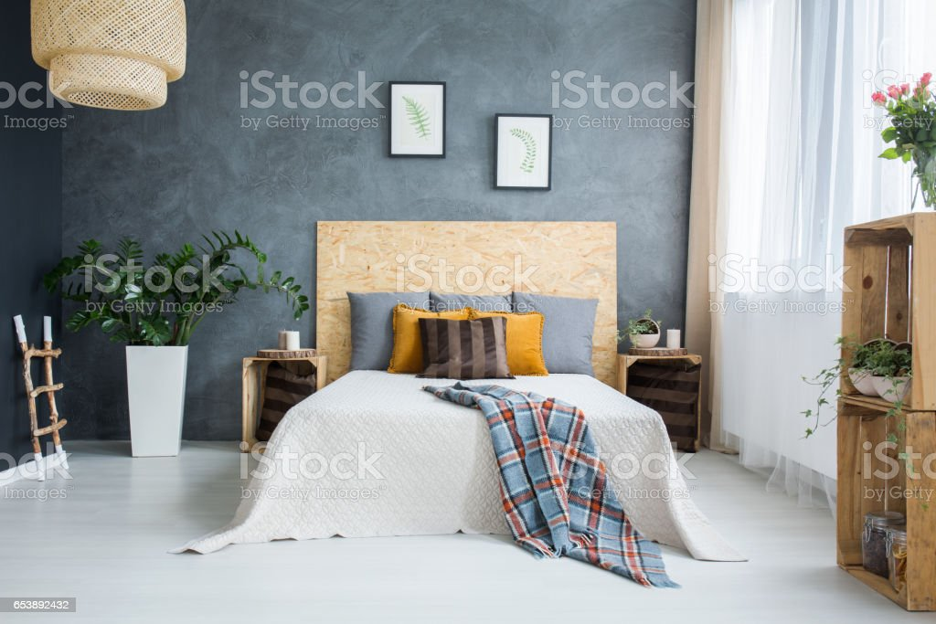 Bedroom with concrete wall stock photo
