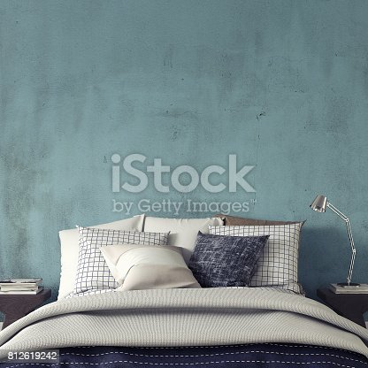 Bedroom with decoration in front of empty blue wall with copy space.