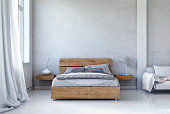Bedroom with decoration on white hardwood floor in front of empty concrete wall with copy space. Slight vintage effect added. 3D rendered image.
