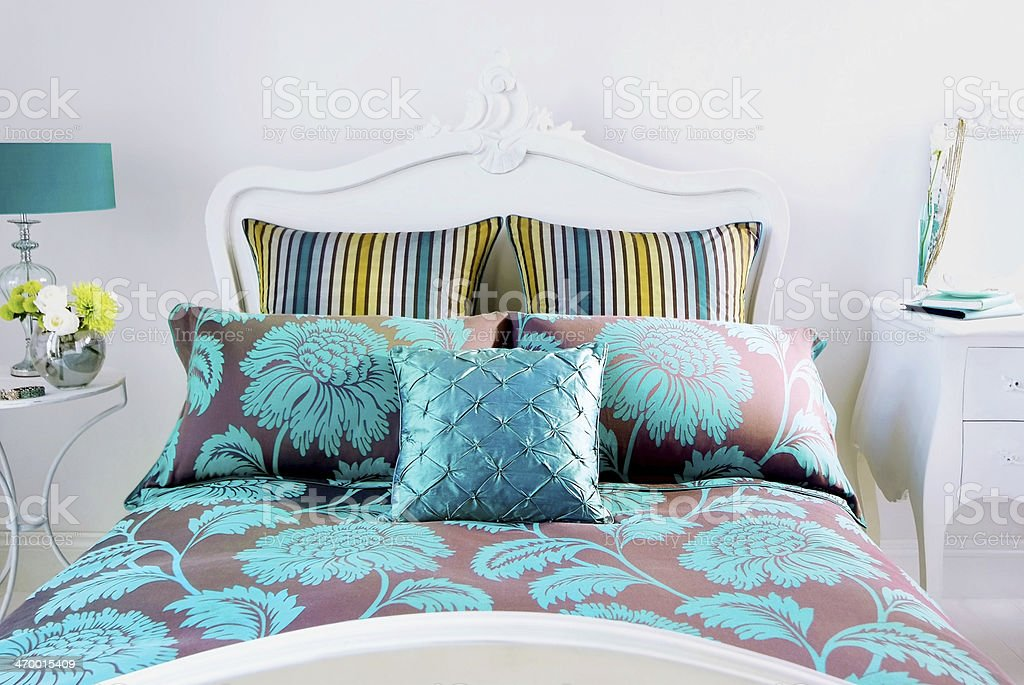 Bedroom with decorative pillows stock photo