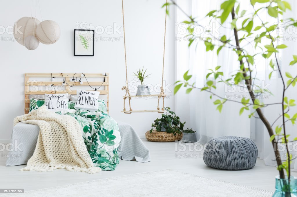 Bedroom with gray pouf stock photo