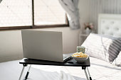 istock Bedroom with laptop on on the bed 1220593351