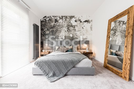 istock Bedroom with large wooden mirror 834429368