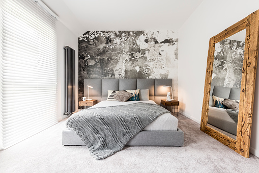 Bedroom with large wooden mirror