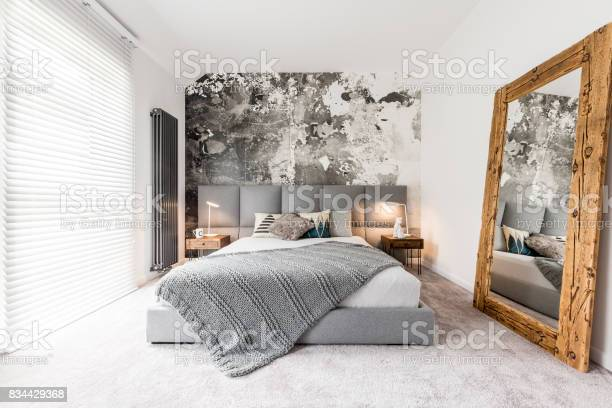 Bedroom with large wooden mirror picture id834429368?b=1&k=6&m=834429368&s=612x612&h=ekj2uccy7mgilxzxcsrmihqwbnct0icyi00ivrmk5g4=