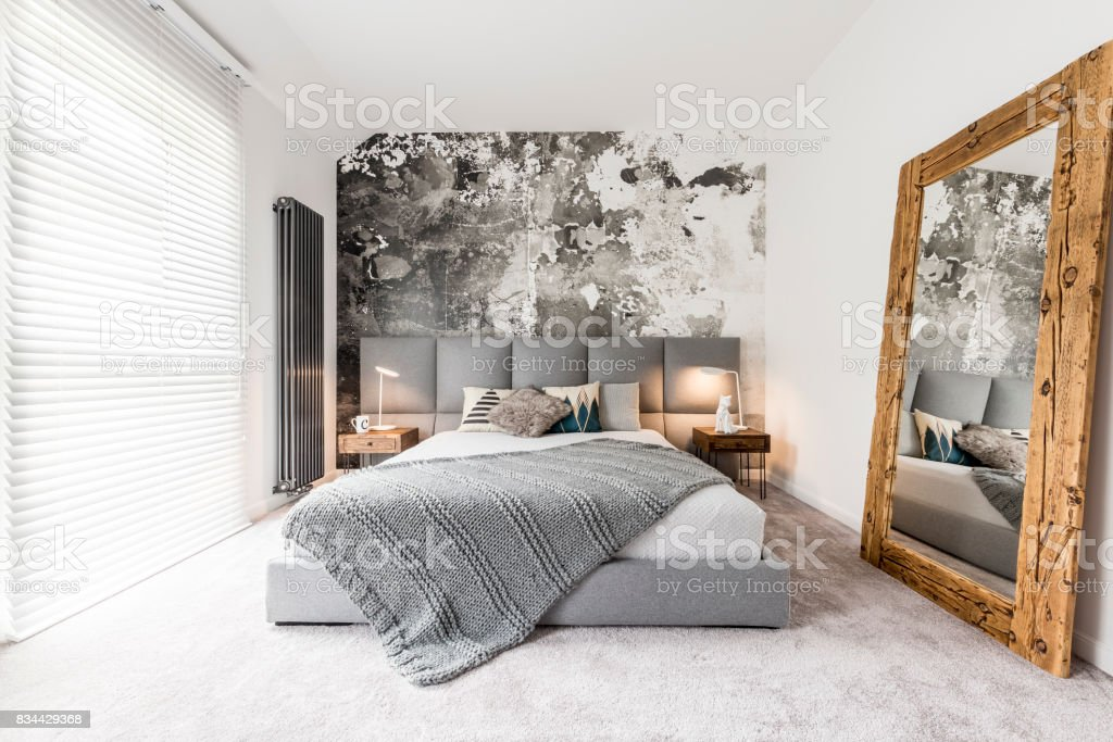 Bedroom with large wooden mirror stock photo