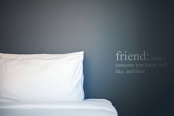 Bedroom with pillow and quote on the wall. stock photo