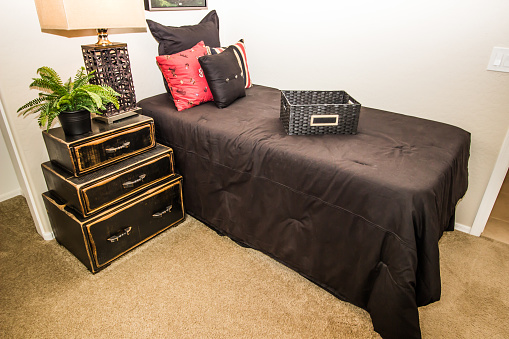 Bedroom With Twin Bed, Lamp And Nightstand
