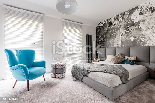 istock Bedroom with vintage blue armchair 834429352