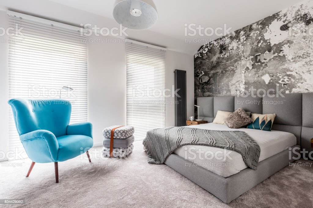 Bedroom with vintage blue armchair stock photo