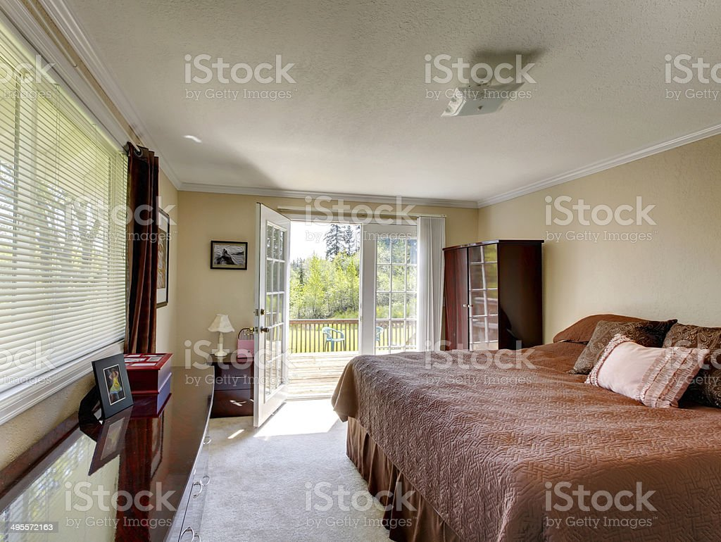Bedroom with walkout deck stock photo