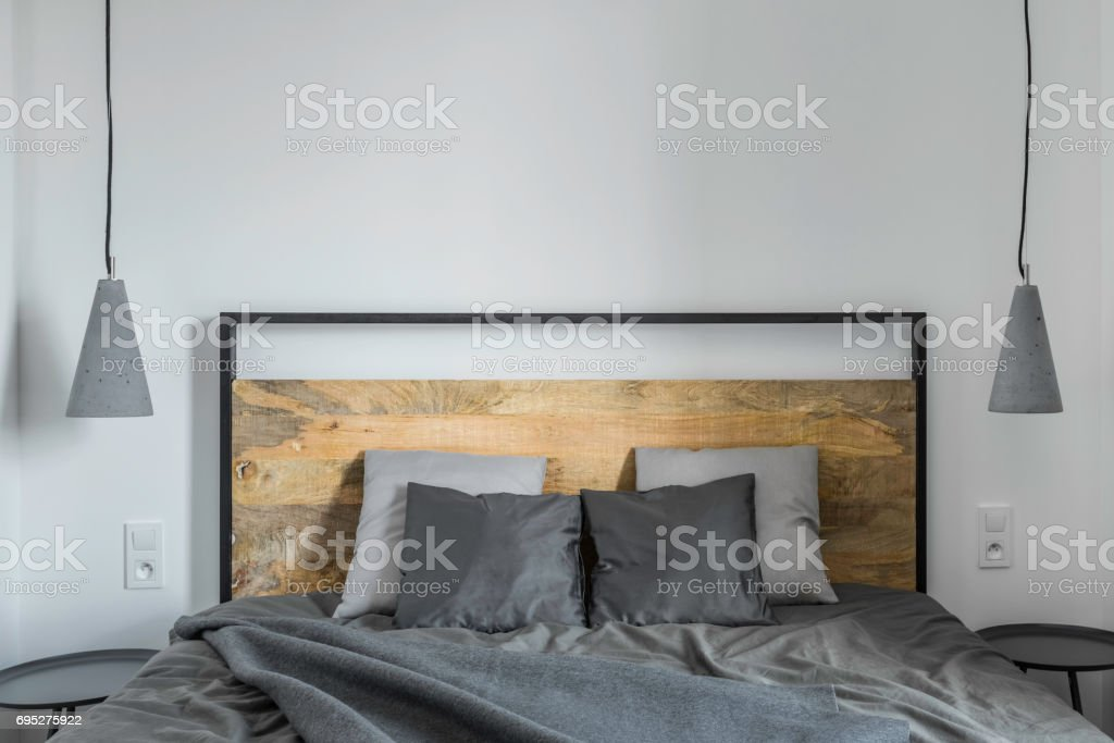 Bedroom with wooden bed stock photo