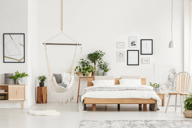 Bedroom with wooden furniture stock photo