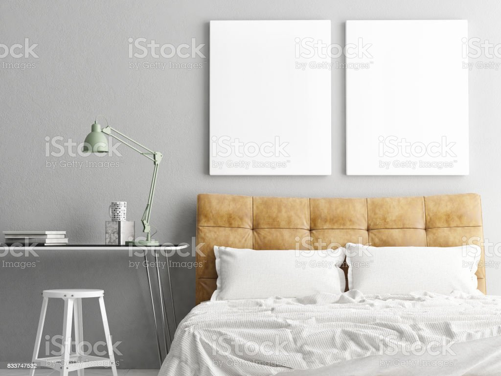 Bedroom with workplace and two mock up posters stock photo