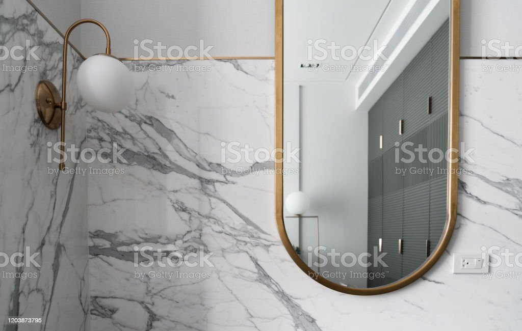 Bedroom Working Corner With Composition Of Gold Stainless Mirror With White Marble Wall And Gold Wall Lamp Interior Design Background Stock Photo Download Image Now Istock