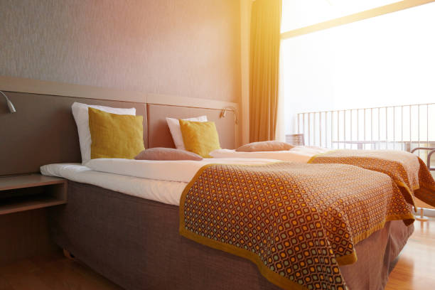 Beds and pillow in hotel room stock photo