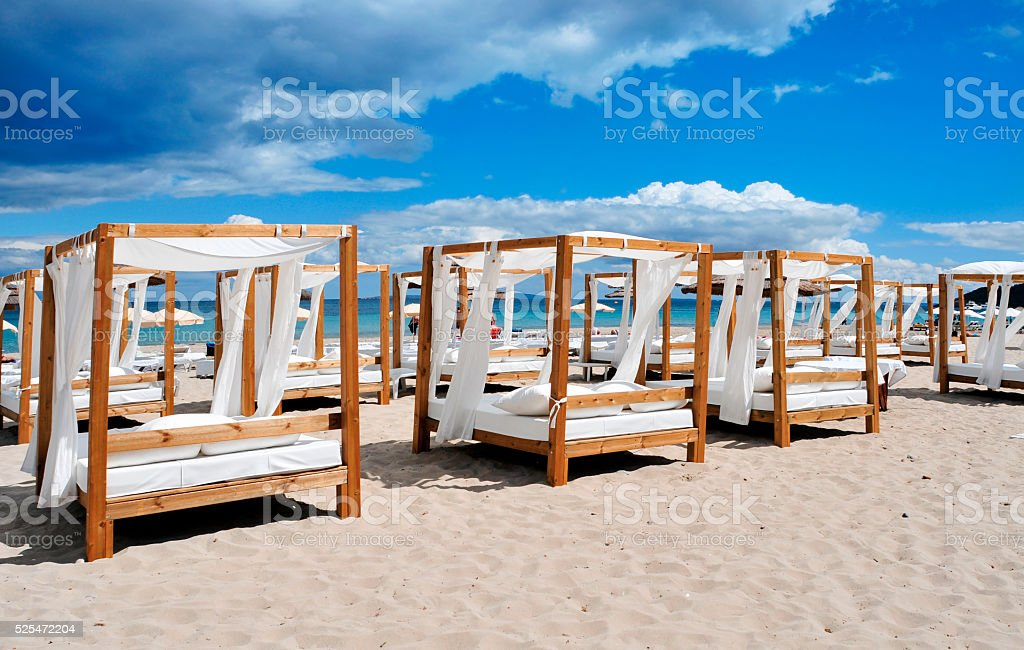 beds and sunloungers in a beach club in Ibiza, Spain royalty-free stock photo