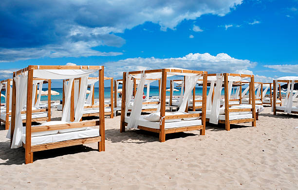 beds and sunloungers in a beach club in Ibiza, Spain stock photo