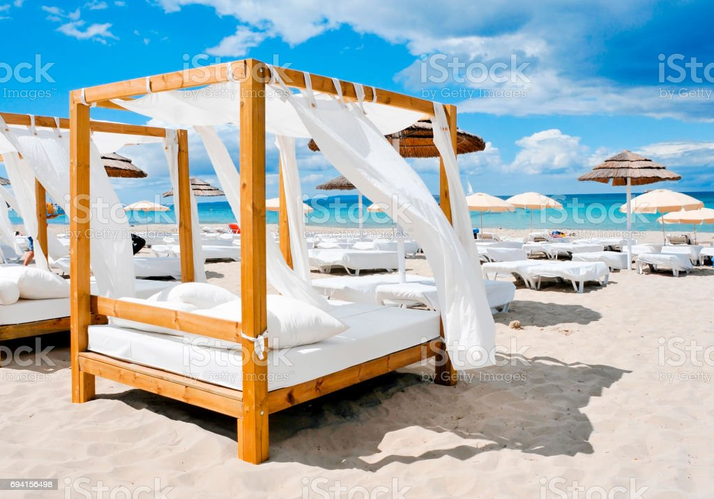 beds in a beach club in Ibiza, Spain stock photo