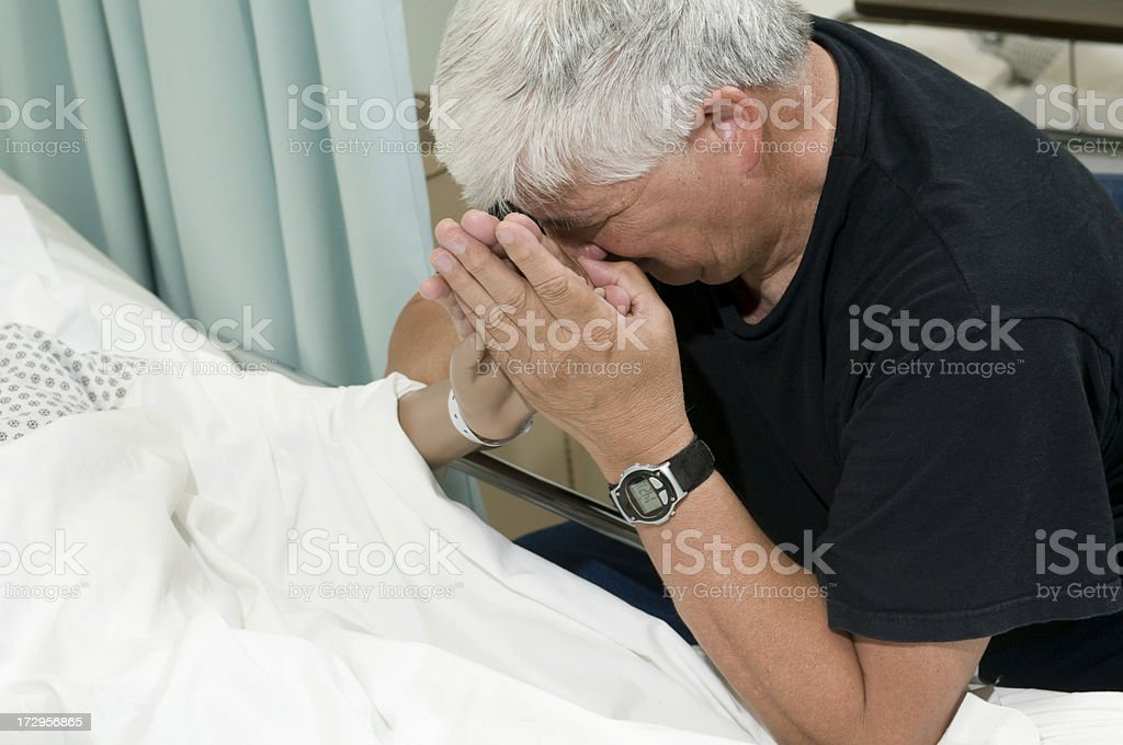 Bedside Grief stock photo