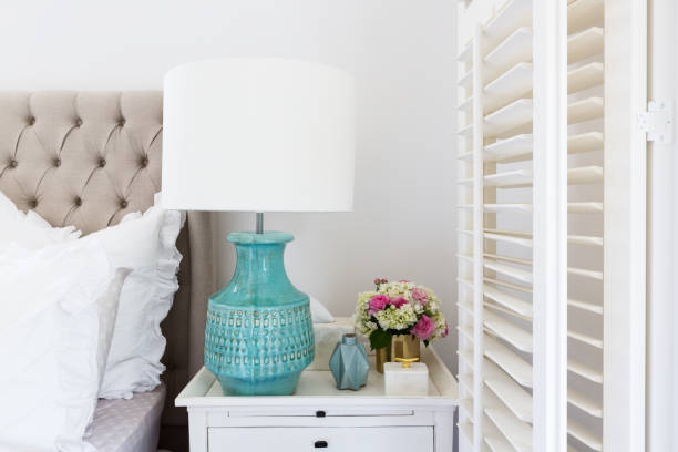Bedside table details in a luxury Hamptons styled bedroom stock photo