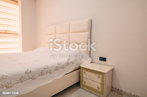 1090975842 istock photo Bedside table in the bedroom next to bed 668811006