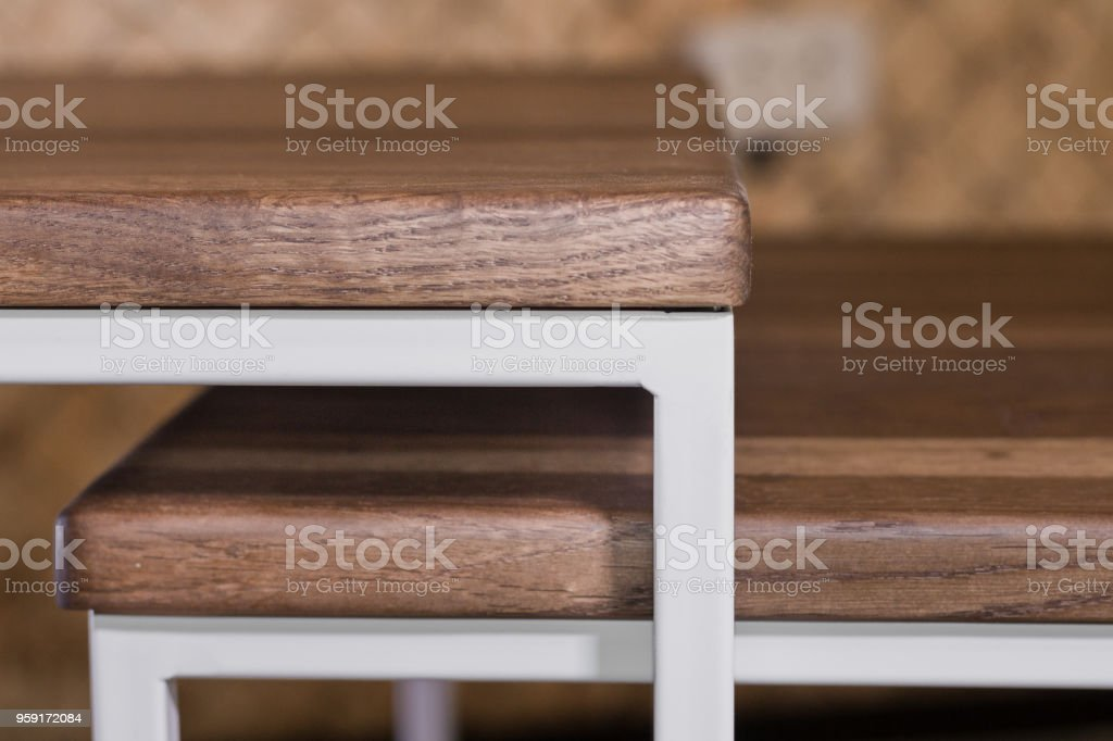 Bedside wooden table in loft style in a room of wood stock photo