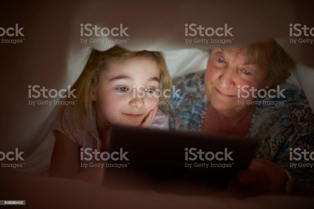bedtime duvet stories with gran stock photo