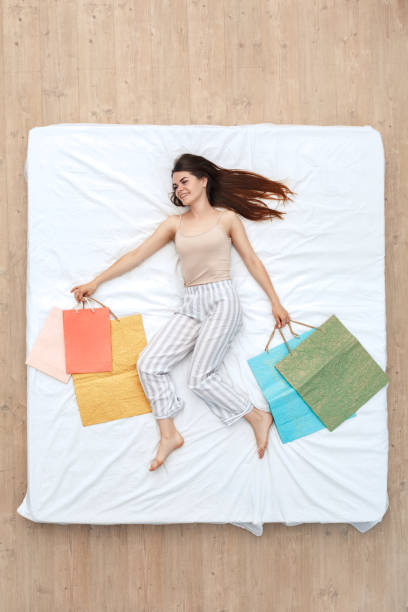 Bedtime young girl lying on bed top view with shopping bags excited picture id1179462687?b=1&k=6&m=1179462687&s=612x612&w=0&h=yhtnsiis2uxzhi xhetkp 5dvfpixtw8uw7wavzwfv8=