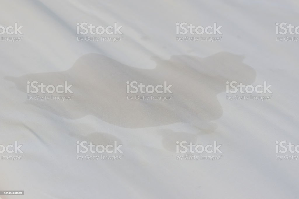 Bedwetting, Adult or children pee on the bed. Selection focus on the wet sheet. stock photo
