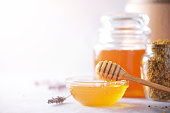 istock Bee pollen granules, honey jar with wooden dropper, honeycomb on grey backdrop. Copy space. Autumn harvest concept 1176629882