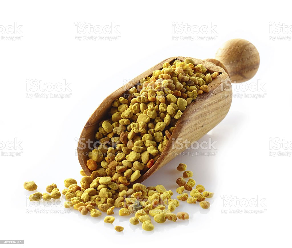 bee pollen in a wooden scoop stock photo