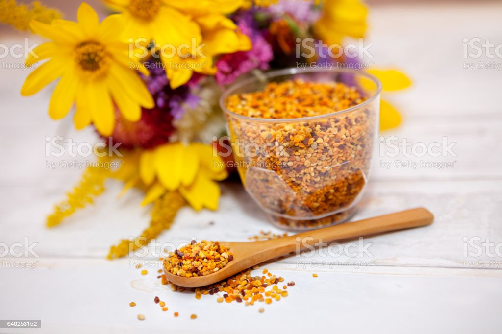 Bee pollen in wooden spoon stock photo