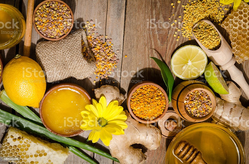 bee products on wooden table stock photo