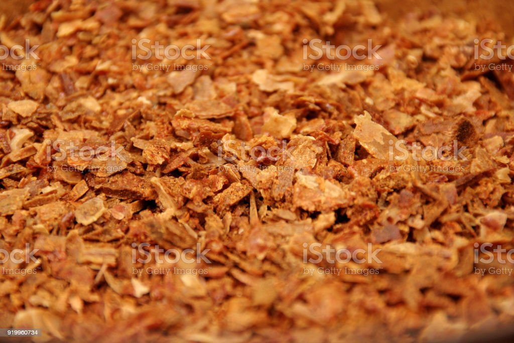 Bee propolis in particles. Macro detail of pieces of fresh natural apiary product called bee glue. stock photo