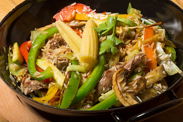 Beef and baby corn stir fry asian fusion dish stock photo