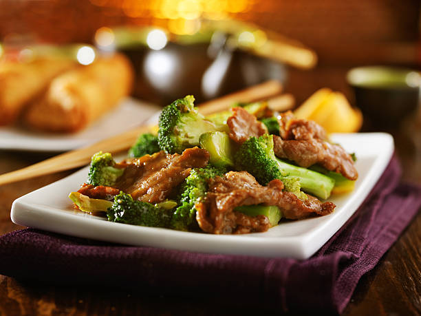 beef and broccoli chinese stirfry - chinese food stock photos and pictures