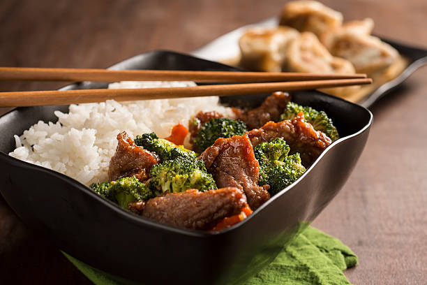 beef and broccoli - chinese food stock photos and pictures