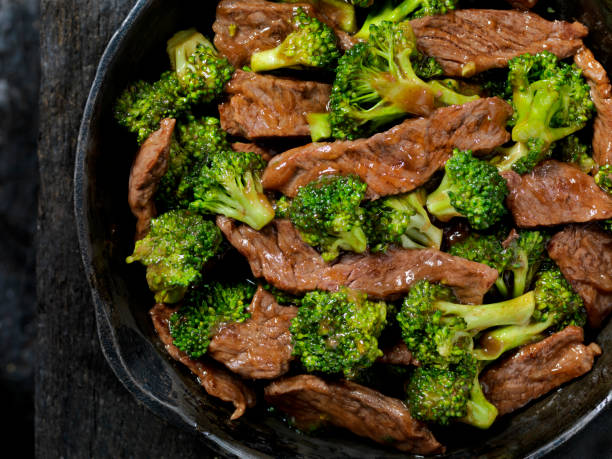 Beef and Broccoli Stir Fry Beef and Broccoli Stir Fry in a Cast Iron Skillet rice noodles stock pictures, royalty-free photos & images