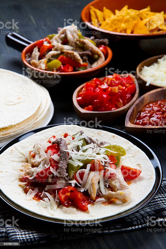 Beef and chicken  Fajitas with colorful bell peppers in  tortill stock photo